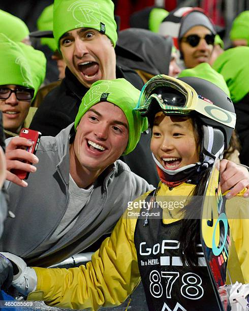 Chloe Kim 13 years old stops for a photo with a fan after her first run in the Winter XGames 2014 women's Snowboard Superpipe final at Buttermilk...