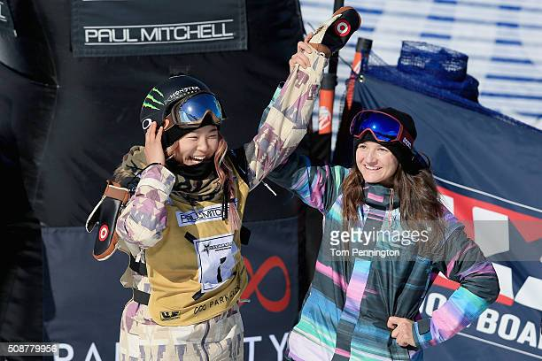 Chloe Kim celebrates a first place finish with Kelly Clark in the ladies' FIS Snowboard World Cup at the 2016 US Snowboarding Park City Grand Prix on...