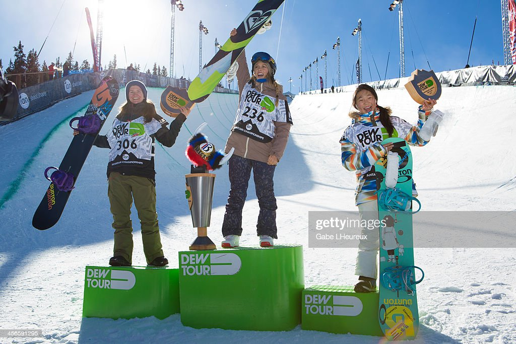 Chloe Kim, Kelly Clark, and Torah Bright standing on top of the podium, in the 2013 Dew Tour half-pipe finals on December 14, 2013 in Breckenridge, Colorado.