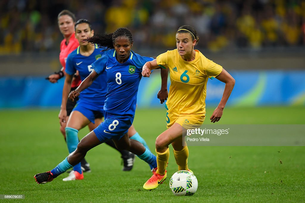 Chloe Logarzo of Australia dribbles against Formiga of Brazil in the first half during the Women's Football Quarterfinal match at Mineirao Stadium on...
