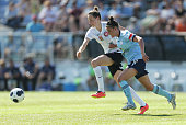 Chloe Logarzo of Sydney is challenged by Rachael Soutar of Wanderers during the round seven WLeague match between Western Sydney and Sydney at Sydney...