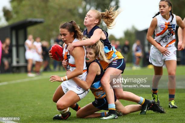 Chloe Molloy of the Calder Cannons is tackled during the TAC Cup Girls round five match between the Calder Cannons and the Bendigo Pioneers at RAMS...