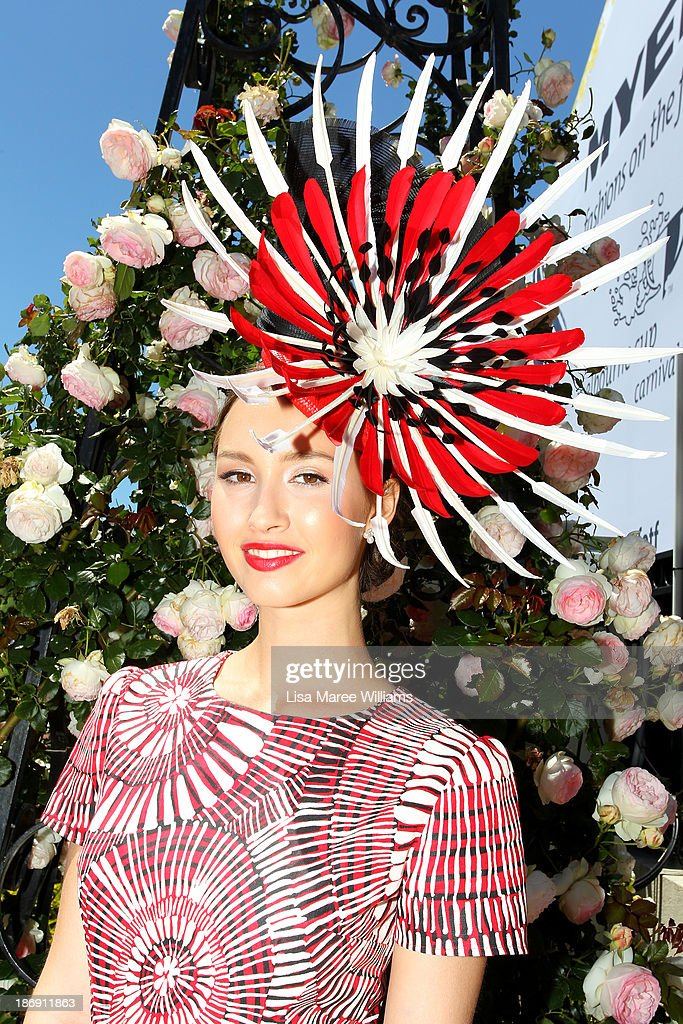 Chloe Moo, daily winner of Fashions on the Field poses, during Melbourne Cup Day at Flemington Racecourse on November 5, 2013 in Melbourne, Australia.