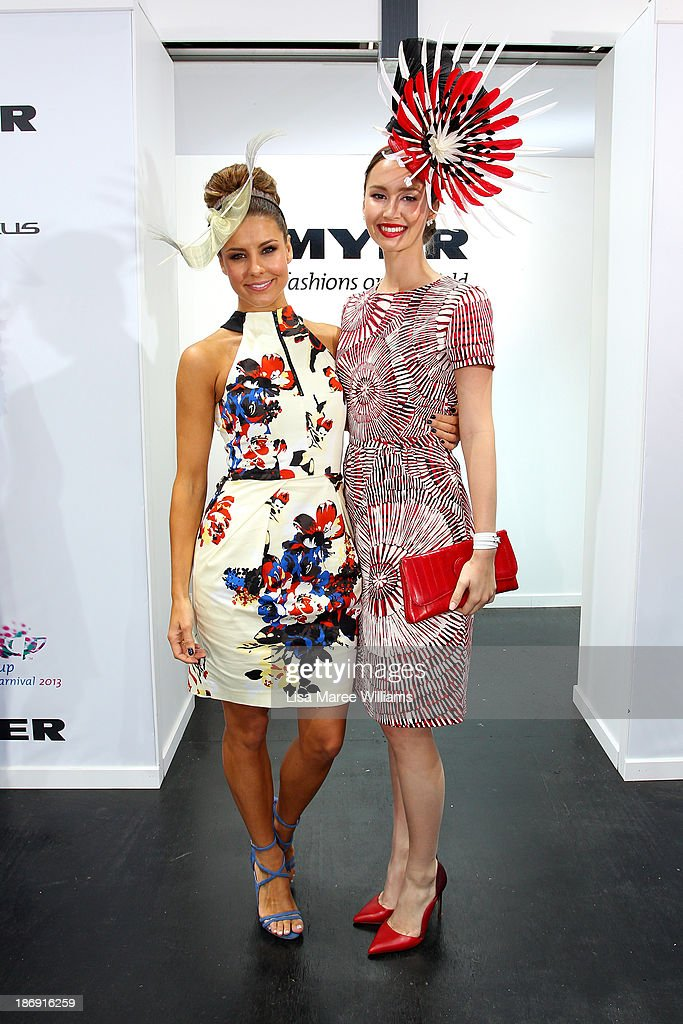 Chloe Moo, daily winner of Fashions on the Field poses with Lauren Phillips, during Melbourne Cup Day at Flemington Racecourse on November 5, 2013 in Melbourne, Australia.