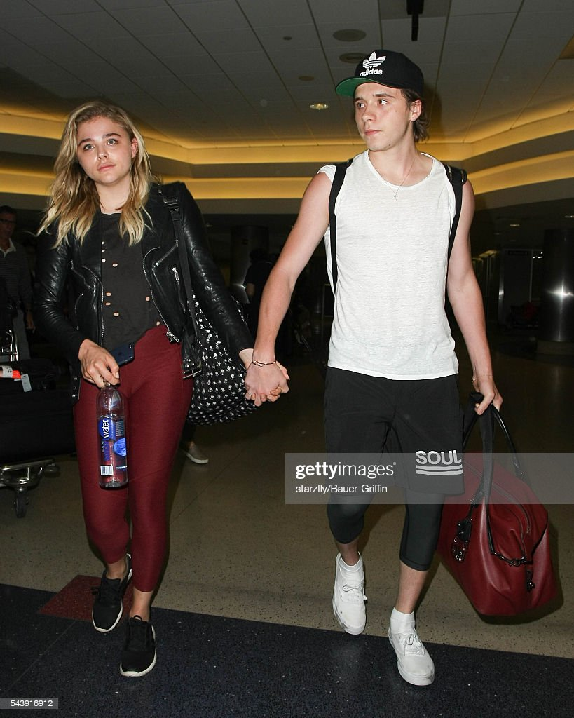 Chloe Moretz and <a gi-track='captionPersonalityLinkClicked' href=/galleries/search?phrase=Brooklyn+Beckham&family=editorial&specificpeople=214623 ng-click='$event.stopPropagation()'>Brooklyn Beckham</a> are seen at LAX on June 30, 2016 in Los Angeles, California.