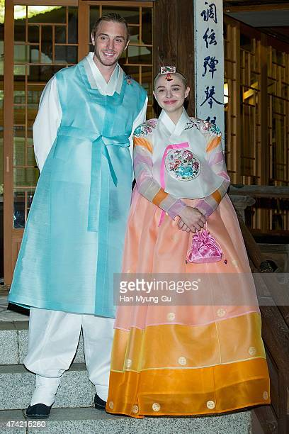 Chloe Moretz fashion detail and brother Trevor Moretz make an appearance as she wearing a South Korean Traditional 'HanBok' costume at the Korea...