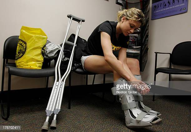 Chloe O'Connell of Welfleet who is going through the new Female Athlete Program straps on boots to protect her feet from the stress fractures in her...
