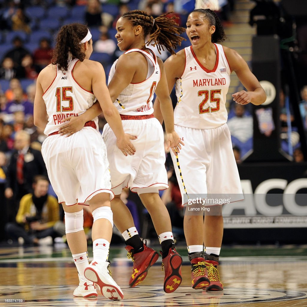 Chloe Pavlech #15, Sequoia Austin #0, and Alyssa Thomas #25 of the Maryland Terrapins celebrate following a play against the Wake Forest Demon Deacons during the quarterfinals of the 2013 Women's ACC Tournament at the Greensboro Coliseum on March 8, 2013 in Greensboro, North Carolina.