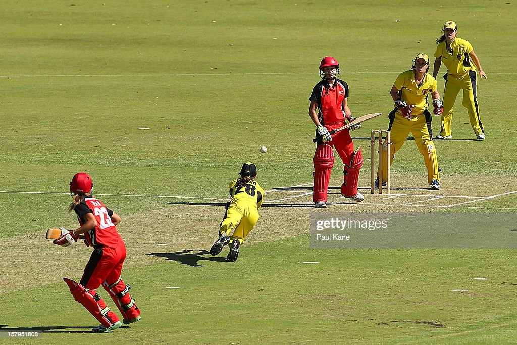 Chloe Piparo of the Fury dives to catch Megan Schutt of the Scorpions during the WNCL match between the Western Australia Fury and the South Australia Scorpions at on December 8, 2012 in Perth, Australia.