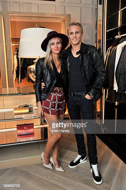 Chloe Roberts and Max Chilton attend the opening of Belstaff House on September 15 2013 in London England