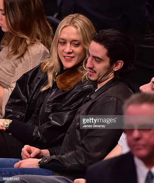 Chloe Sevigny and guest attend Milwaukee Bucks vs New York Knicks game at Madison Square Garden on April 10 2015 in New York City