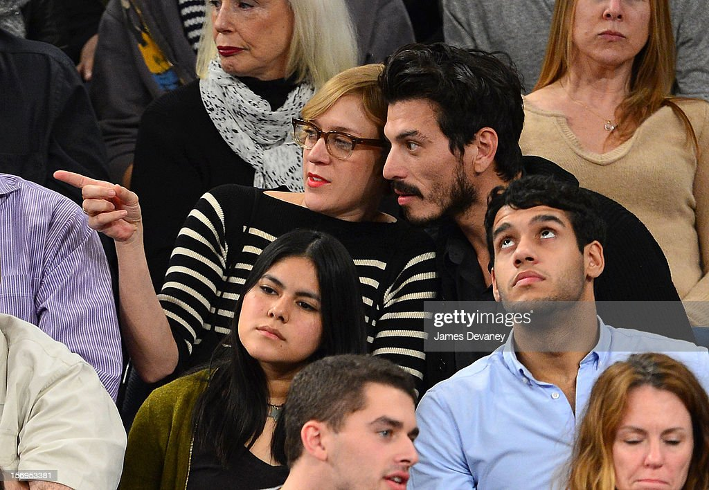 <a gi-track='captionPersonalityLinkClicked' href=/galleries/search?phrase=Chloe+Sevigny&family=editorial&specificpeople=201550 ng-click='$event.stopPropagation()'>Chloe Sevigny</a> (L) attends the Detroit Pistons vs New York Knicks game at Madison Square Garden on November 25, 2012 in New York City.
