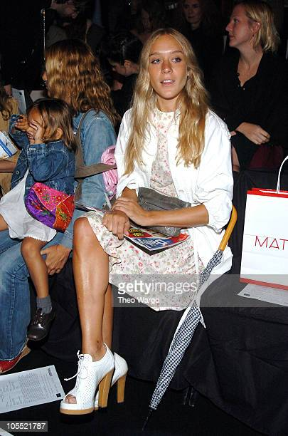 Chloe Sevigny during Olympus Fashion Week Spring 2005 Imitation of Christ Front Row at Theater Tent Bryant Park in New York City New York United...