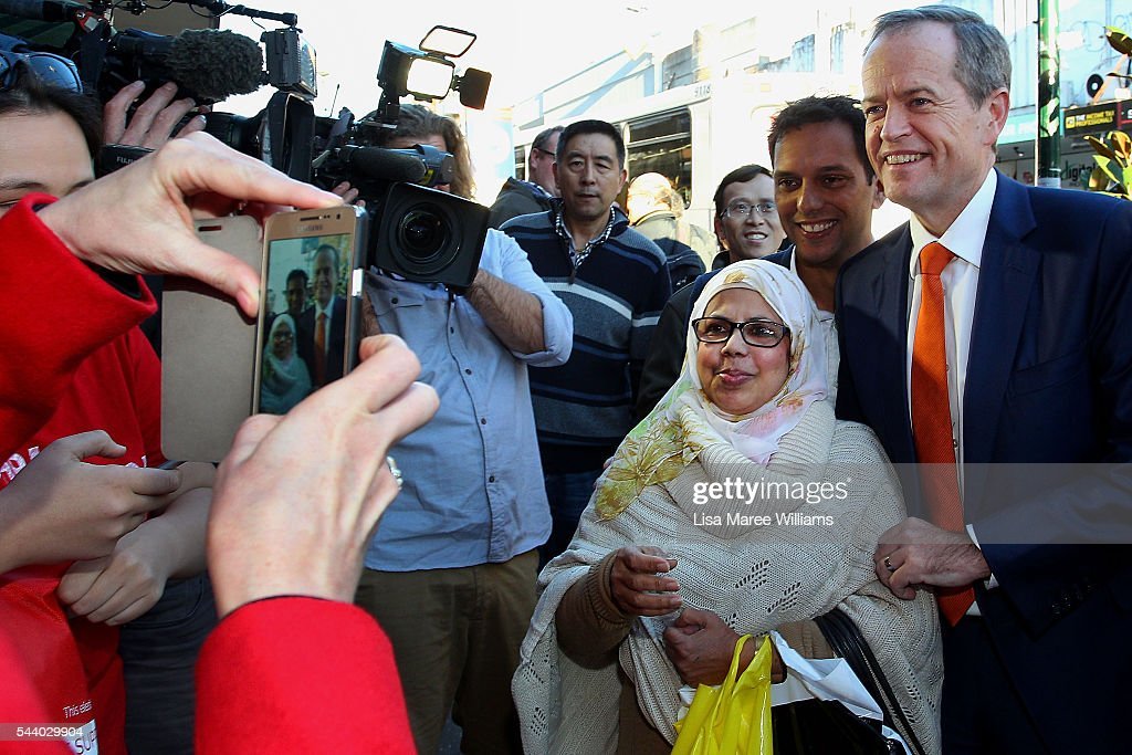 Chloe Shorten takes a photo of Opposition Leader, Australian Labor Party <a gi-track='captionPersonalityLinkClicked' href=/galleries/search?phrase=Bill+Shorten&family=editorial&specificpeople=606712 ng-click='$event.stopPropagation()'>Bill Shorten</a> and a local woman during a street walk in Hurstville on July 1, 2016 in Sydney, Australia. <a gi-track='captionPersonalityLinkClicked' href=/galleries/search?phrase=Bill+Shorten&family=editorial&specificpeople=606712 ng-click='$event.stopPropagation()'>Bill Shorten</a> is campaigning heavily on Medicare, promising to make sure it isn't privatised if the Labor Party wins the Federal Election on July 2.