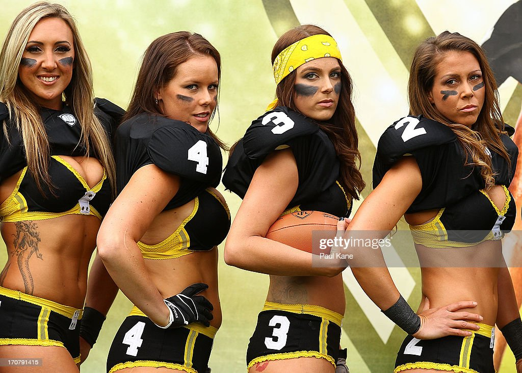Chloe Stout, Elise Chapman, Leah Turnbull and Sara Stanford of the Western Australian Angels pose for a team photo after being introduced to the media during a Legends Football League (LFL) media day at nib Stadium on June 18, 2013 in Perth, Australia.