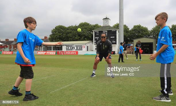 Chloe Tryon of South Africa coaches local school children during an ICC Cricket fo Good clinic at Grace Road on June 30 2017 in Leicester England
