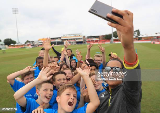 Chloe Tryon of South Africa takes a selfie with local school children during an ICC Cricket fo Good clinic at Grace Road on June 30 2017 in Leicester...