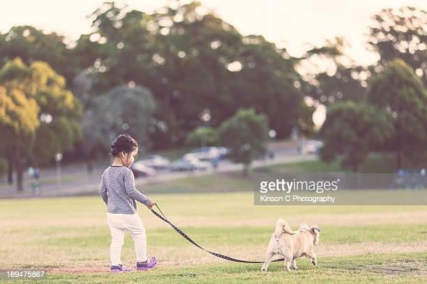 Chloe walking a dog