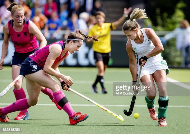 TOPSHOT Chloe Watkins of Ireland fights for the ball with Amy Costello of Scotland during the women's Rabo EuroHockey Championships 2017 match...