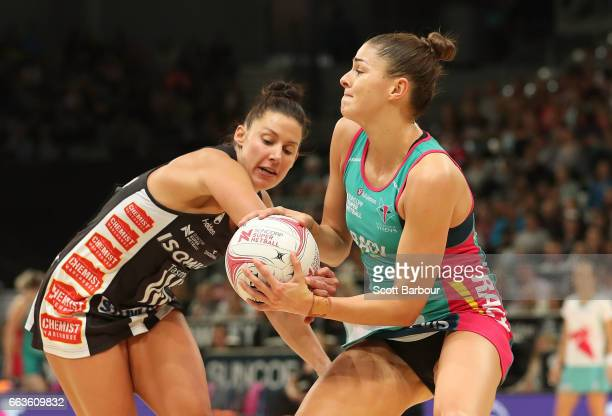 Chloe Watson of the Vixens and Madi Robinson of the Magpies compete for the ball during the round seven Super Netball match between the Magpies and...