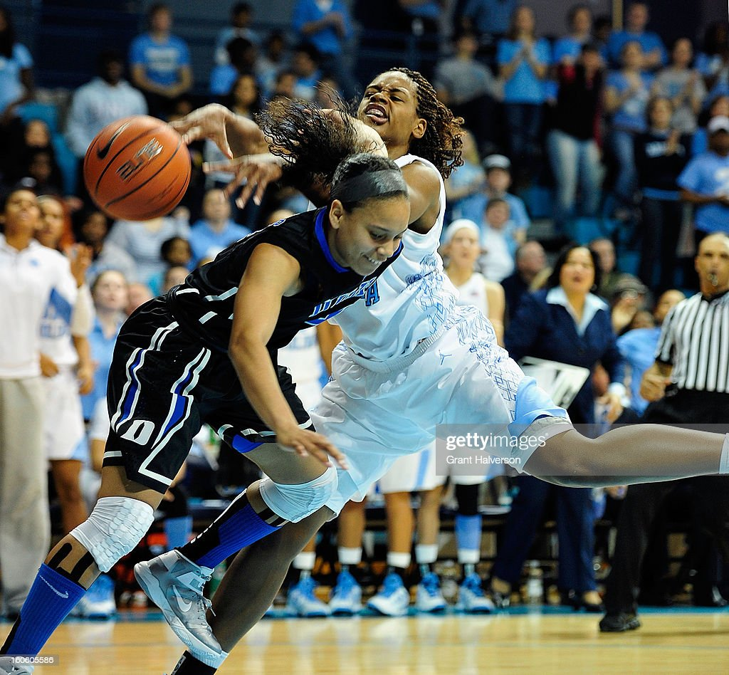 Chloe Wells #4 of the Duke Blue Devils collides with Xylina McDaniel #34 of the North Carolina Tar Heels during play at Carmichael Arena on February 3, 2013 in Chapel Hill, North Carolina. Duke won 84-63.
