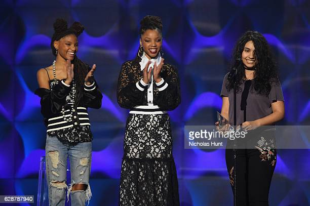 Chloe X Halle present Alessia Cara with an award on stage at the Billboard Women in Music 2016 event on December 9 2016 in New York City
