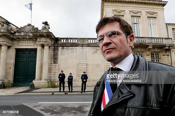 ChâlonsenChampagne's mayor Benoist Apparu takes part in a demonstration on October 16 2014 in front of the Marne Prefecture to protest against the...