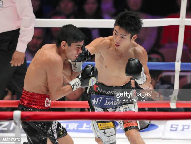 Chmpion Kenshiro Teraji of Japan connects his right on challenger Pedro Guevara of Mexico in the 2nd round during their WBC Light Flyweight Title...