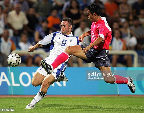 Cho Byung Kuk of Korea competes with Dimitrios Salpingidis for Greece in the men's football preliminary match on August 11 2004 during the Athens...