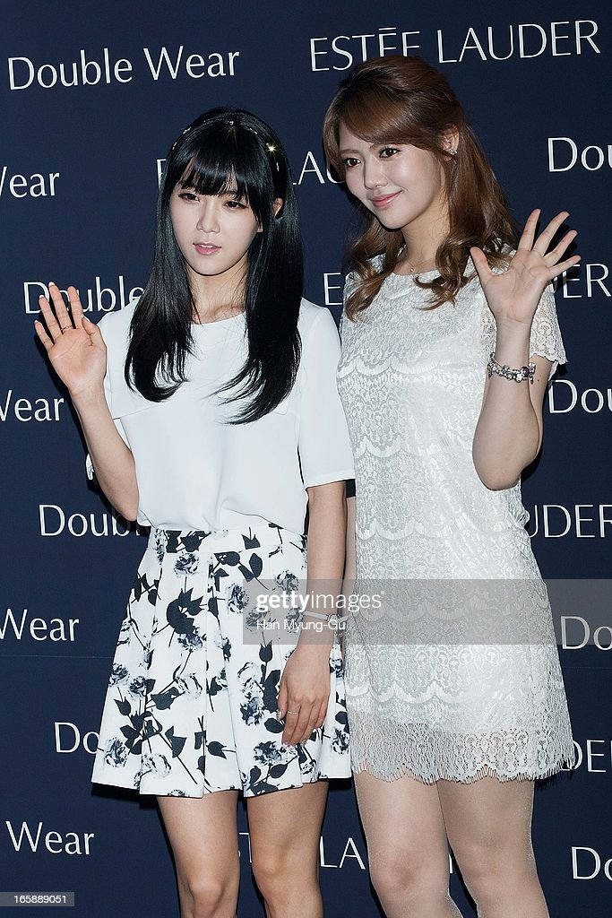 Cho Hyun-Young and Jung Yoon-Hye (Chung Yoon-Hye) of South Korean girl group Rainbow attend the 'Estee Lauder' Double Wear Lounge opening at Coffee Smith on April 5, 2013 in Seoul, South Korea.