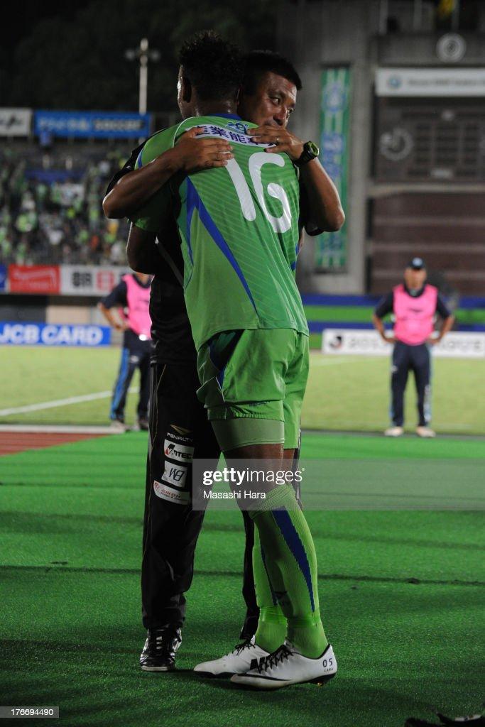 Cho Kwi Jae,coach of Shonan Bellmare hugs with Wellington after the J.League match between Shonan Bellmare and Jubilo Iwata at BMW Stadium Hiratsuka on August 17, 2013 in Hiratsuka, Kanagawa, Japan.
