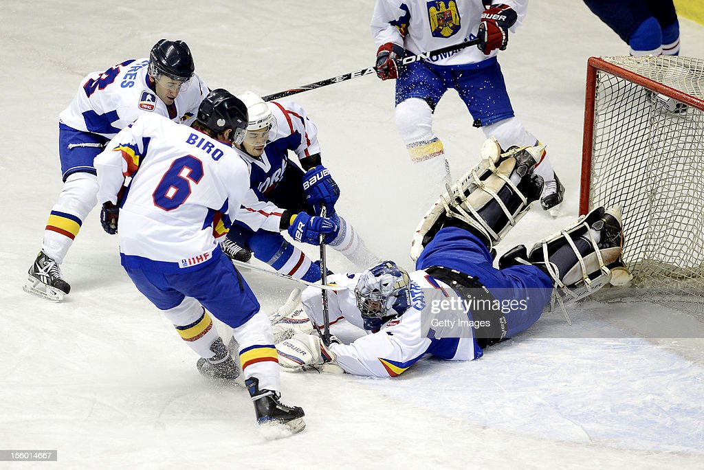 Cho Min Ho #9 of South Korea fails to score while Magor Petres (1L) #16, Otto Biro (2L) #6 and Adrian Catrinoi (1R) #1 of Romania defend during the Ice Hockey Sochi Olympic Pre-Qualification Group J match between South Korea and Romania at Nikko Kirifuri Ice Arena on November 11, 2012 in Nikko, Tochigi, Japan. South Korea won 2-0.