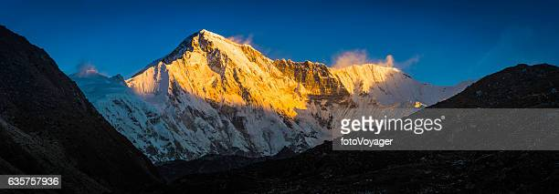 Cho Oyu 8201m Himalaya mountain peak illuminated by golden light