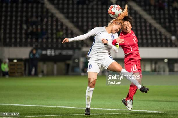 Cho Sohyun of South Korea and Sung Hyang Sim of DPR Korea in action during the EAFF E1 Women's Football Championship between North Korea and South...