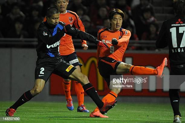 Cho Young Cheol of Omiya Aldija scores the first goal during the JLeague match between Omiya Ardija and Urawa Red Diamonds at Nack 5 Stadium Omiya on...