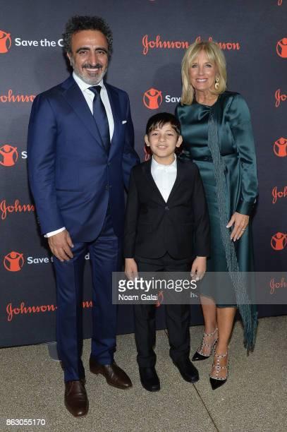 Chobani Founder and CEO Hamdi Ulukaya Syrian Refugee and Save the Children beneficiary Mahmoud Aloqla and Save the Children Board Chair Dr Jill Biden...