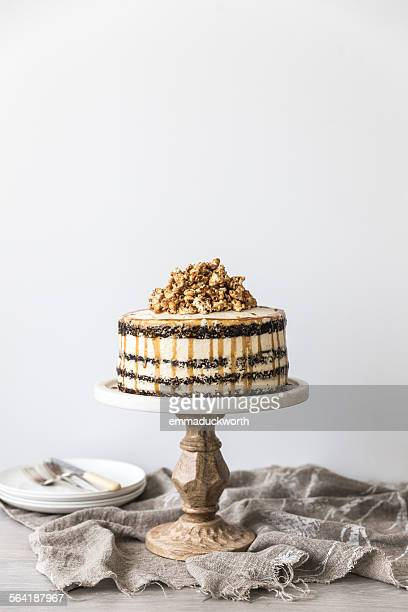 Chocolate and caramel buttercream layered birthday cake with caramel popcorn