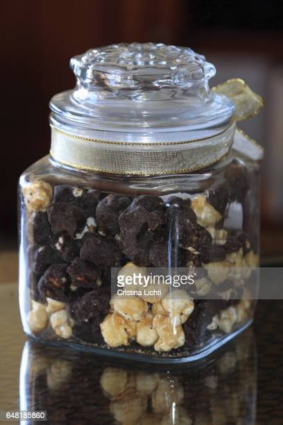 Chocolate and caramilized pop corn in a glass container