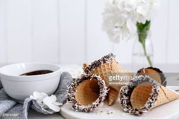 Chocolate and coconut coated ice-cream cones