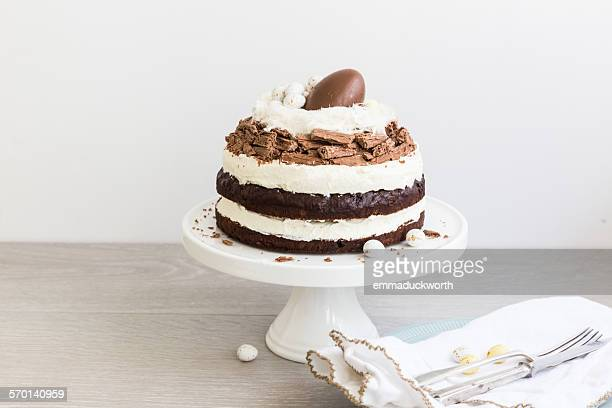 Chocolate and cream easter cake on cake stand