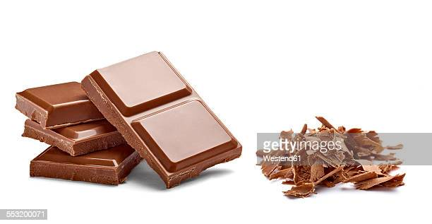 Chocolate bar and chocolate shaving on white background