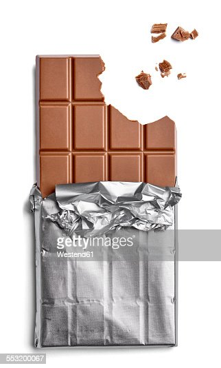 Chocolate bar and crumbs on white background