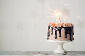 Chocolate drip cake with sparkler for a birthday or celebration