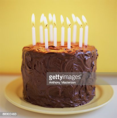 Chocolate Cake Images Birthday With Candles : Chocolate Cake Candle Stock Photos and Pictures Getty Images