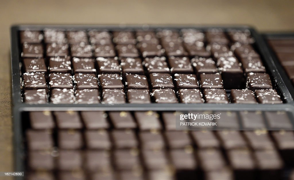 Chocolate boxes are pictured at French chef Alain Ducasse's new establishment, the 'Manufacture de chocolat' (Chocolate Factory), on February 19, 2013 in Paris.