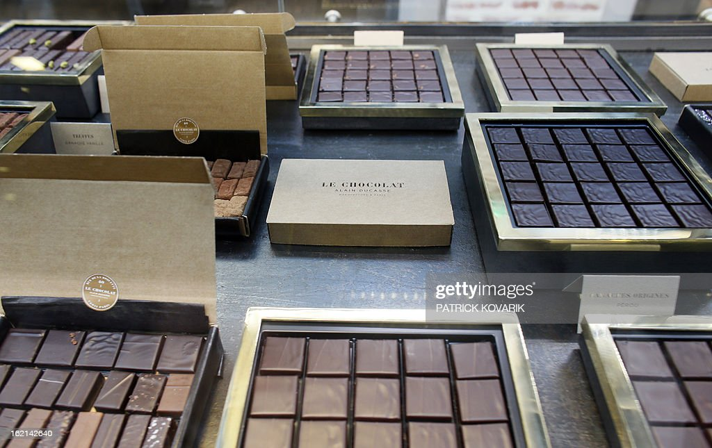 Chocolate boxes are pictured at French chef Alain Ducasse's new establishment, the 'Manufacture de chocolat' (Chocolate Factory), on February 19, 2013 in Paris. AFP PHOTO / PATRICK KOVARIK