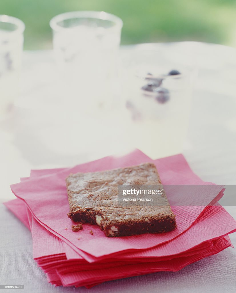 Chocolate brownie on a stack of napkins. : Stock Photo