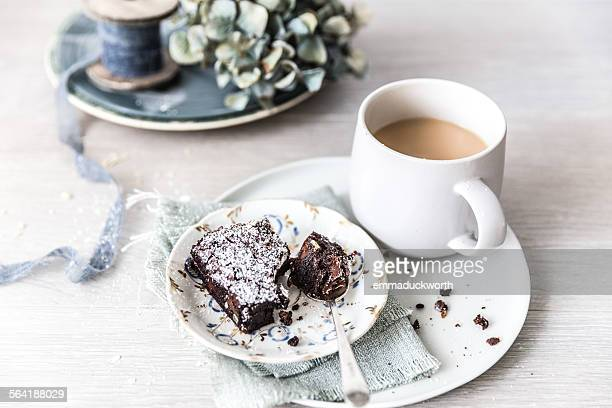 Chocolate brownie with a cup of tea