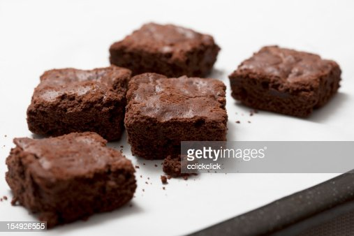 Chocolate brownies on white countertop
