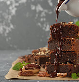 Chocolate brownies with nuts on a gray background